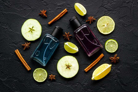 Men perfume bottles with fruits and flowers, top view Standard-Bild