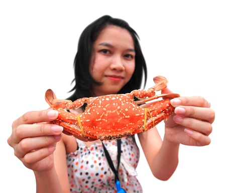 Woman that hold steam crab in her hand