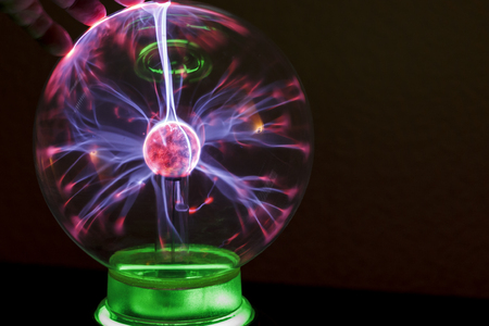 Corona discharge in a gaseous medium with the example of fingers and coil Tesla. Plasma ball.