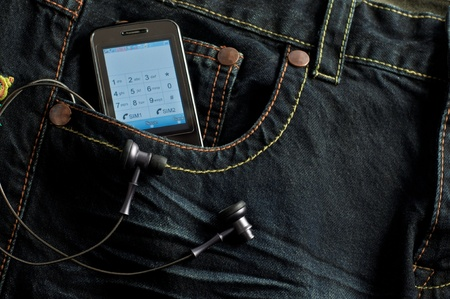 Mobile Phone  in a jeans pocket  photo