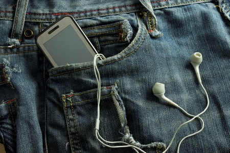 cable stitch:  Mobile Phone  in a jeans pocket (includes clipping path for screen)  Stock Photo