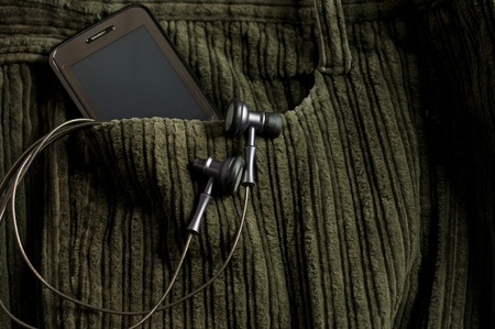 cable stitch: Mp3 player and  Mobile Phone  in a brown jeans pocket