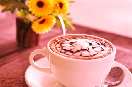 Close-up of a delicious cup of coffee or hot chocolate  photo