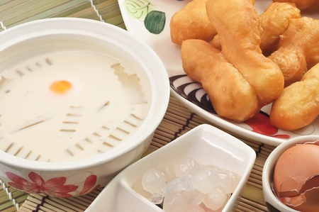 soymilk: Soymilk in a glass and deep-fried doughstick with egg,Thai breakfast