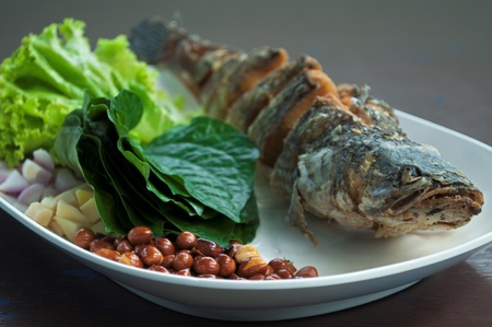 delicious thai food ,food wrapped in leaves with fried snake fish