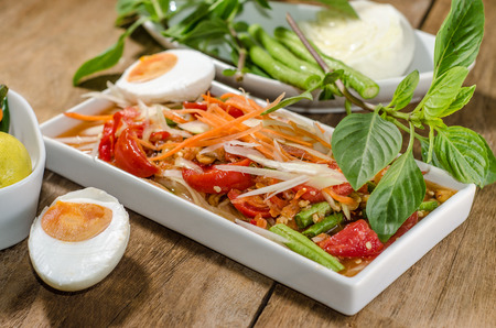 Papaya salad spicy salted eggs at a food stand   Thailand photo