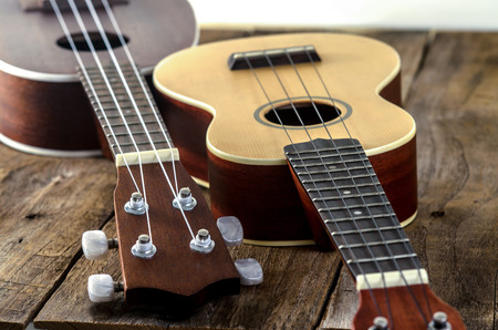 acoustic ukulele: ukuleles  on  wooden background