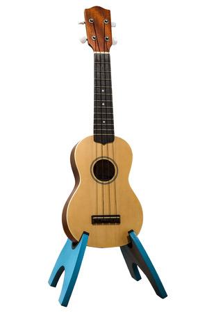 knocked out: Un ukulele de madera, noqueado, con trazado de recorte