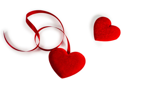 Two Red  Hearts  with red ribbon isolated on white  with path  photo