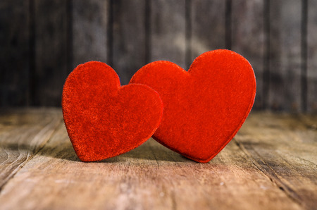 Two Red  on wood background photo