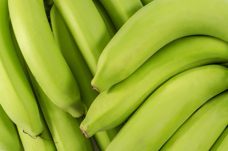 Macro shot of  Bunch of bananas isolated on white background   Clipping path included photo