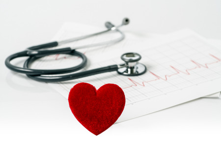 stethoscope and red heart on  electrocardiogram photo