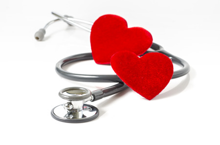 stethoscope and red heartl on white background photo