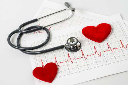 stethoscope and two red heart on  electrocardiogram Stock Photo