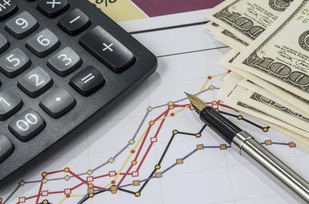 fountain pen and calculator on the financial graph Standard-Bild