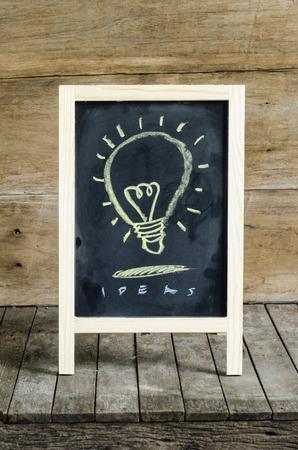 Light Blub Chalkboard Drawing on wooden background