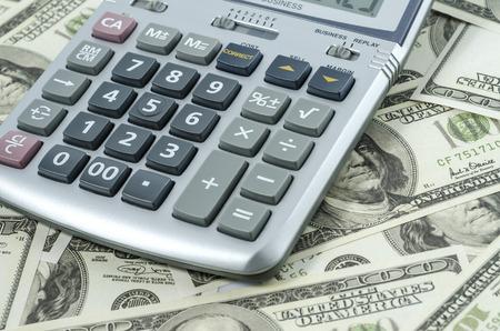 international bank account number: Calculator on a background of american dollar bills