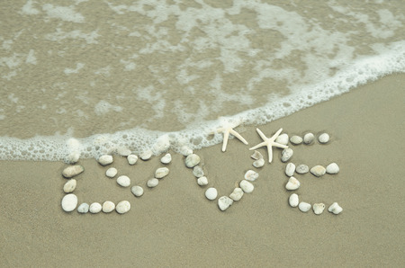 ビーチで書かれて単語の愛 写真素材