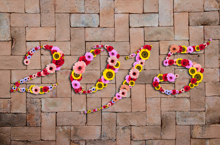 2015 Flowers on festive on Brick Seamless Texture  Background photo