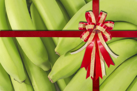 Red Ribbon on Bunch of bananasfor background photo