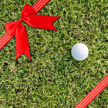 christmas golf: Red  Cross ribbon bow on Texture backgronud