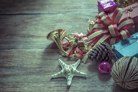 Christmas garland on rustic wooden background with copy space, retro style toned picture photo