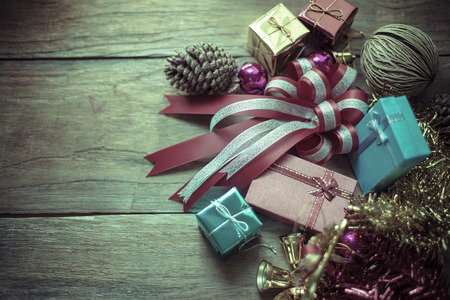 Christmas garland on rustic wooden background with copy space: retro style toned picture