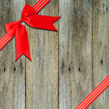 panelling: Red  Cross ribbon bow on Texture backgronud