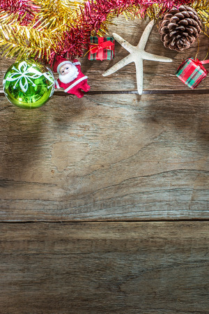 Top view of  Christmas garland on rustic wooden background with copy space photo