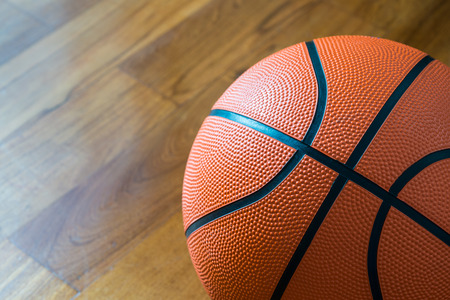 Closeup of Basketball on the Court Floor photo