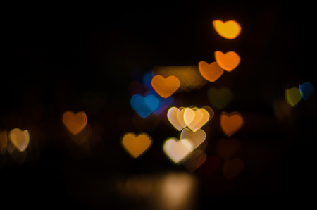 Multicolour bokeh Heart shape ,defocused bokeh lights as background photo