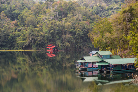 Houseboats in the dam of thailand. Stock Photo