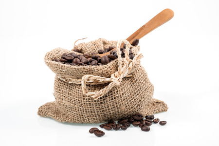 Studio Shot of coffee beans in bag isolated on white background photo