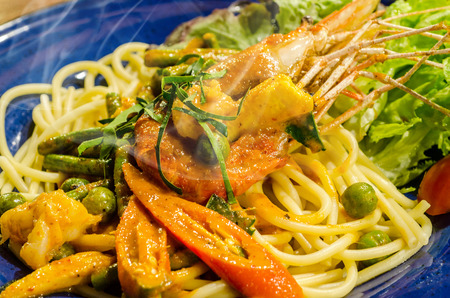 Spaghetti with Spicy Prawn,Asian spicy seafood noodles photo