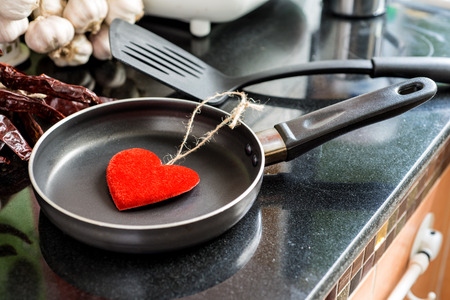 nonstick: Eggs in a frying pan for Love or Heart Healthy Cooking Concept Stock Photo