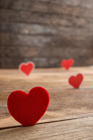 Red Valentine hearts on old rustic wooden background. Valentines day. photo