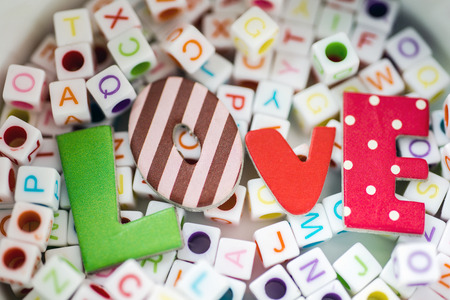 Love message written over  letter blocks,Selective focus photo