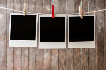 pack string: Three blank instant photos hanging on the clothesline.Clipping path for insert Photo