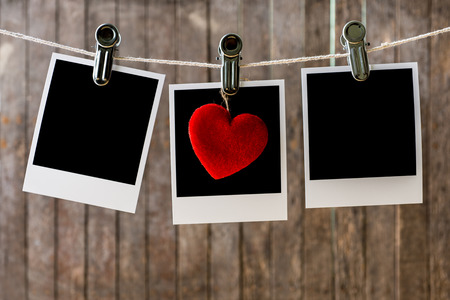 Three blank instant photos hanging on the clothesline.Clipping path for insert Photo photo