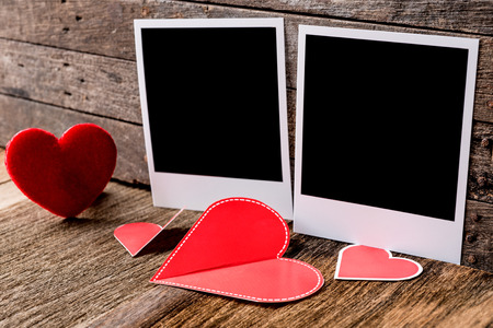 Two photo frames and valentines day  heart over wooden background,.Clipping path for insert Photo photo