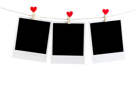 in insert: Three Old picture frame hanging on the clothesline over white,Clipping path for insert Photo Stock Photo