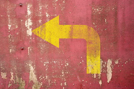 left turn road sign painted on wall,vintage wall background photo