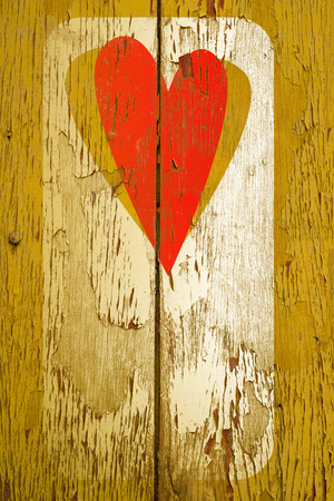 drawing love symbol on old wooden wall photo