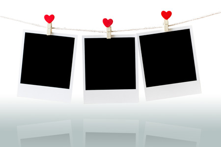 Three Old picture frame hanging on the clothesline over white,Clipping path for insert Photo 免版税图像