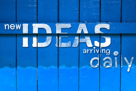 lowering: new idea text on yellow Old Wood Background,vintage wall background