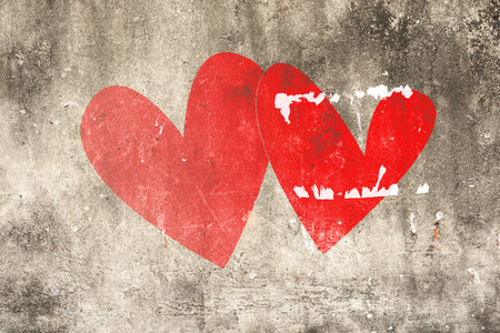 Two hearts drawing on cracked concrete ,vintage wall background photo