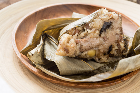 dim sum: Asian Chinese rice dumplings or zongzi  on wooden background