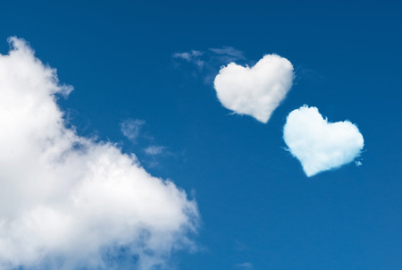 blue sky with hearts shape clouds. Love concept