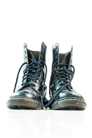 The high black leather boots isolated on white background photo