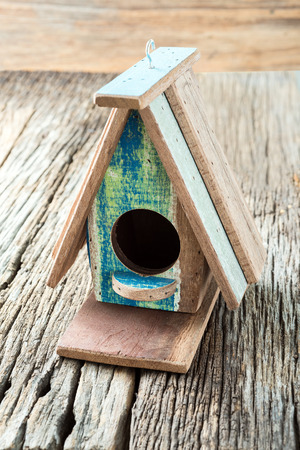 bird s house: Studio Shot of  Bird House on wooden background